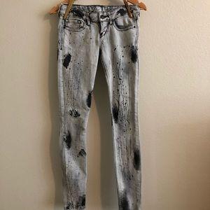 Express paint splatter skinny jeans
